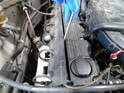 Use a screwdriver to pry up the spark plug wire cover.