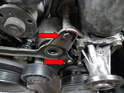 Remove the two 13mm bolts from the tensioner bracket (red arrows).