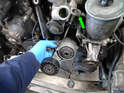 Depending on the condition and age of your car, the tensioner, shock and adjuster arm can be slipped down and out of the engine.