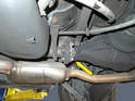 Unfasten the six nuts and bolts (yellow arrow) connecting the drive shaft, flex disc and differential.