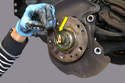 Use a 5mm hex socket to loosen the clamp on the axle nut (yellow arrow).