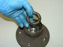 Once the old oil seal is removed, you can extract the rear wheel bearing from the hub.