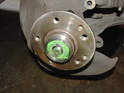 Fit the bearing into the wheel hub.