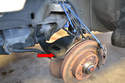 When reinserting the spring make sure the lower portion sits in its proper place in the control arm (red arrow).