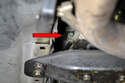 From underneath the car, take a 10mm socket and unscrew the bolt holding the speedometer cable in the transmission.