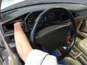 If your arms are thin enough reach in behind the cluster through the opening in the air vent and disconnect the speedometer cable from the instrument cluster.