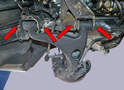 There are two eccentric bolts and nuts (red arrows) that you need to remove connecting the wishbone to the chassis.