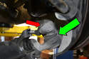 Remove the 19mm nut and bolt on the clamping sleeve to the ball joint (red arrow).