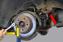 Hang the caliper safely to the body (red arrow), do not let it hang by the brake line.
