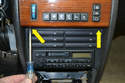 Remove the two small Phillips-head screws (yellow arrows) from under the climate panel.