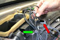 Wiggle the wiring harness out from the top driver side of the heater box (red arrow), and cut the plastic wrap holding the wiring loom (green arrow).