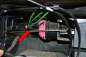 Behind where the center console was and under the heater box are three vacuum lines connected to pink vacuum elements (red arrow).
