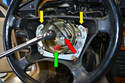 Use a 10mm Hex and breaker bar to remove the screw holding the wheel to the shaft (red arrow).