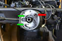 With the steering wheel removed, you will see a metal plate that holds the horn contacts (green arrows) and the airbag contacts (red arrow).