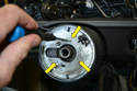 To remove the plate you will need to remove the three very small Phillips head screws (yellow arrows).