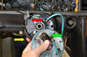 To get the plate completely off the steering shaft you will need to remove the airbag harness.