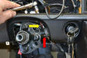 Use a 10mm socket and extension to loosen but not remove the pinch collar securing the steering lock in the steering shaft (yellow arrow).