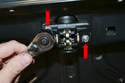 Remove the two 8mm bolts (red arrows) holding the locking mechanism in place.