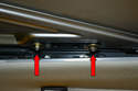 Close the roof and remove the two 8mm nuts (red arrows) holding the panel to the rail assembly.