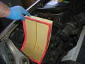 Remove the old air filter from the housing.