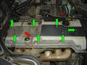 Now remove the 5mm hex bolts securing the valve cover insert piece to the valve cover (green arrows).