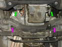 Shown here is the location of the two engine mounts (green arrows) looking up at the bottom of the car.