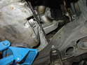 Place a floor jack under the oil pan of the engine with a block of wood or rubber between the jack and the pan.