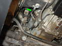 Shown here is the general location of the electrical connector (directly above the starter) from underneath the car (green arrow).