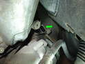 Shown here is the location of the sensor retaining bolt (green arrow).