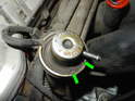 Once the vacuum connection is removed, locate the circlip (sometimes called a snap ring) that holds the regulator in place.
