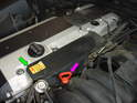 Begin by removing the upper air intake tube that runs along the top of the valve cover.