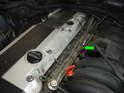 Remove the cap covering the fuel pressure test port (green arrow).