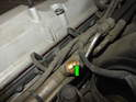 Place a rag next to the Schrader valve inside (green arrow) and use a small screwdriver to press the valve down.