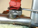 Set the fuel rail in a vise and remove the small clips that secure each injector to the fuel rail.
