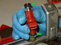 Pull each injector up and out of the fuel rail.