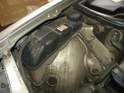 The first step in replacing the old coolant tank is to remove the airbox from the car.
