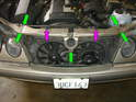 Now locate the five 10mm bolts holding the upper portion of the radiator support frame to the car (green arrows).