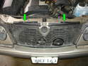 Now climb out from under the car and remove the two plastic pins holding the outer fan grille in place (green arrows).