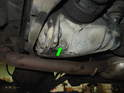 The drain plug is located on the right side of the differential toward the rear (green arrow).