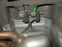 Have a helper support the rear exhaust assembly where it meets the catalytic converters.