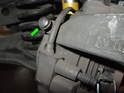With the car firmly supported on jackstands, remove the wheels and locate the bleeder screw on the brake caliper.