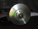 Shown here is the new brake disc fitted to the wheel hub.