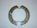 ThisPicture shows the new brake shoes with the new springs properly oriented when you install them on the car.
