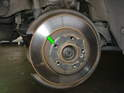 Begin by removing the brake pads and caliper from the rear wheels (refer to our article on replacing rear brakes for more info).