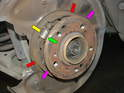 Once off, you'll see the components that make up the parking brake.