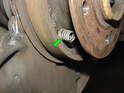Next remove the two brake shoe retaining springs (green arrow).