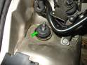 Install the new rubber grommet over the shock rod (green arrow).
