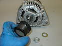 Transfer the pulley to the new alternator and use the new 24mm nut and lock washer, secure it to 80 Nm (59ft/lbs.
