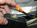 Once the airbag is free, pull the orange electrical connector out of the side of the airbag and set the airbag aside.