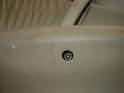 Remove the trim plug underneath the door pull.